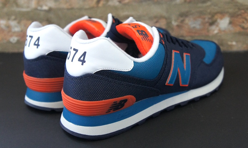 new balance 574 navy and orange
